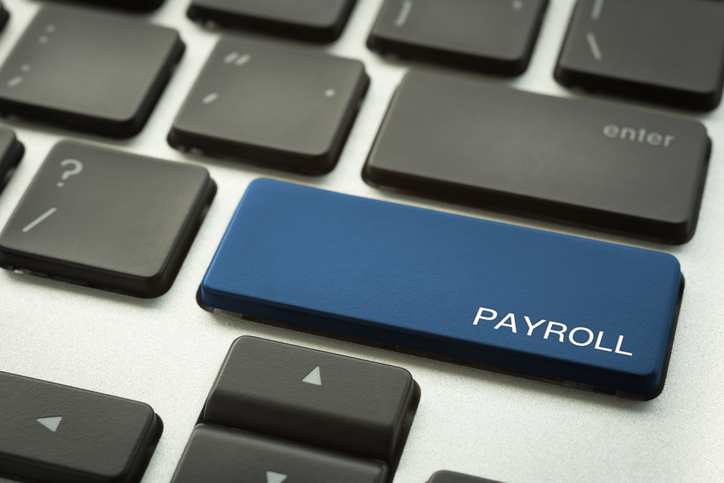 Laptop keyboard button with word PAYROLL.